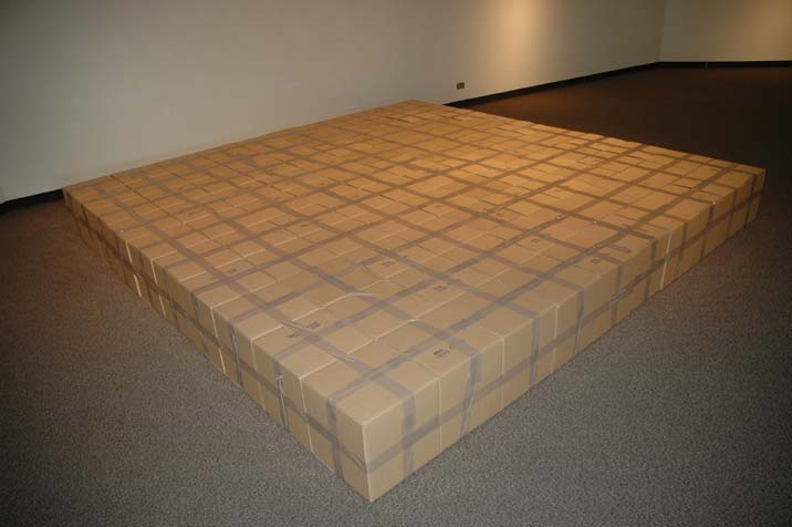 all these things. 10′ × 10′ × 1′. 100 corrugated cardboard boxes with packaging tape, each 12″ × 12″ × 12″.
