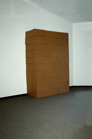 bloc. 3′ × 7′ × 10′. 50 corrugated cardboard boxes, each 24″ × 12″ × 12″.