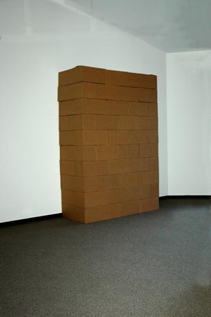 bloc. 3′ × 7′ × 10′. 50 corrugated cardboard boxes, each 24″ × 12″ × 12″.